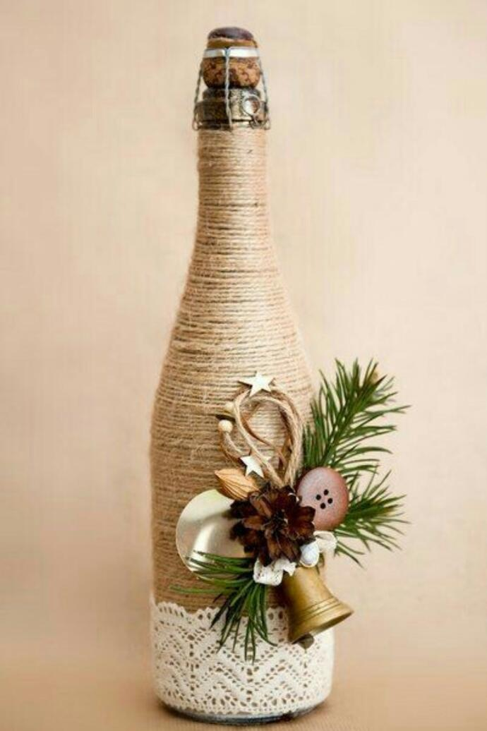 вариант упаковки бутылки шампанского с применением шпагата